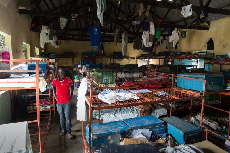 Bombo,  Uganda - Ein Junger Mann steht in einem Schlafsaal des Don Bosco Vocational Training Centre Bombo.