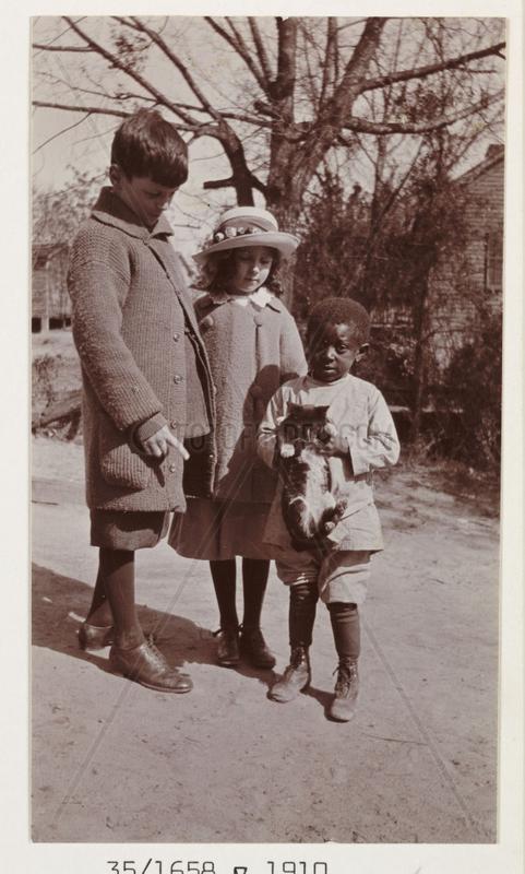Three children,  c 1910.