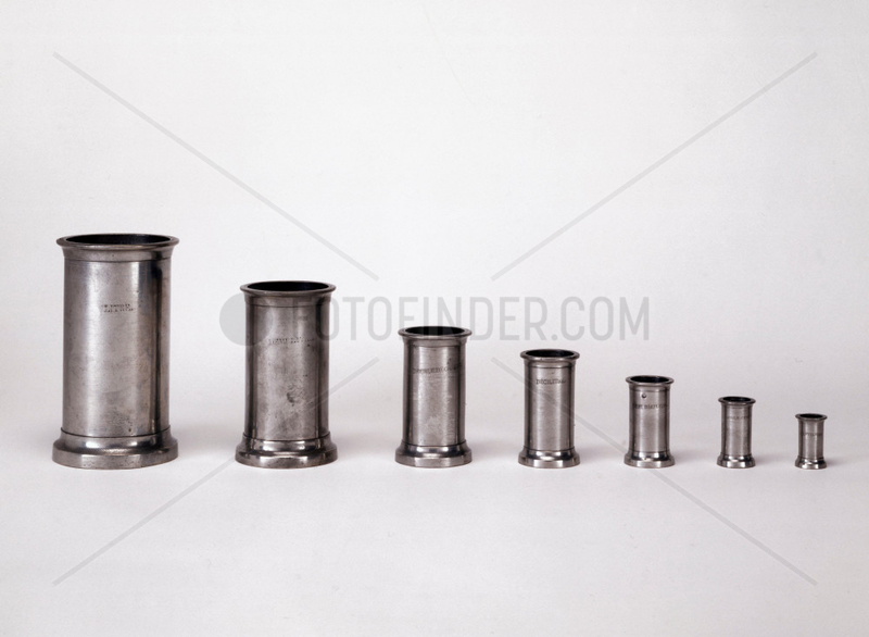 Seven liquid measures made from pewter,  1851.