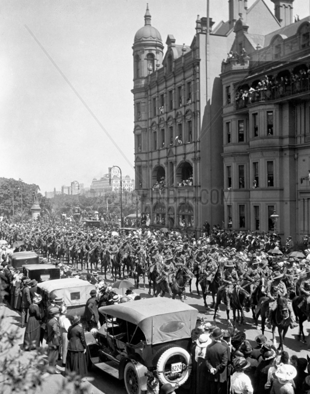 Mounted regiment passing through a crowded