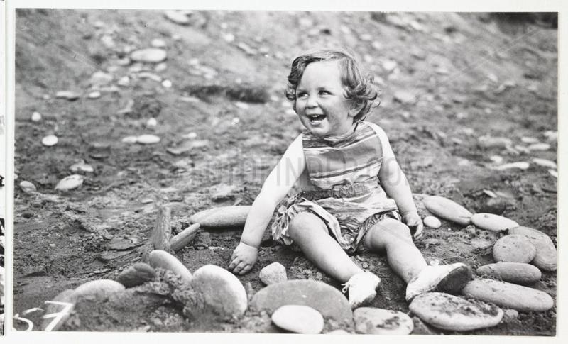 Girl on a beach,  c 1930.