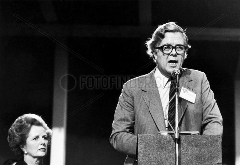 Margaret Thatcher listening to Geoffrey Howe,  Blackpool,  October 1981.