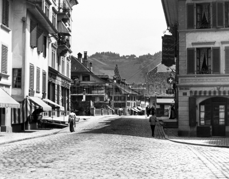 View along a cobblestone street of a Swiss