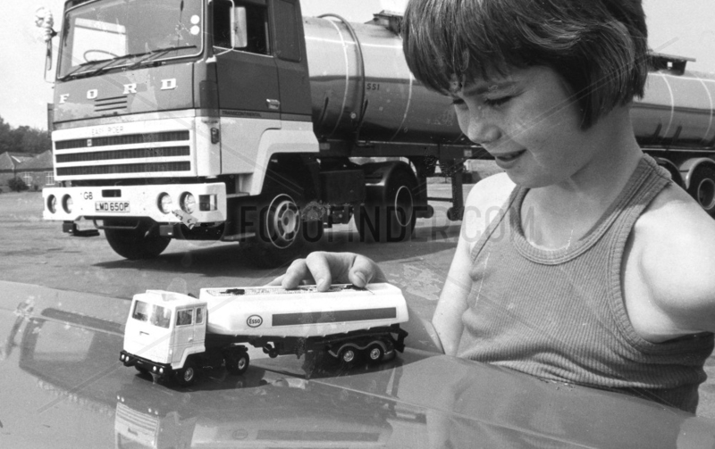 Boy with toy oil tanker,  November 1977.