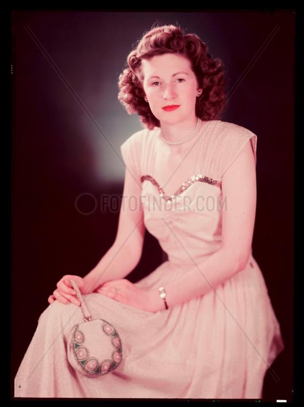 'Miss B Hall (Testing Department)' wearing an evening dress,  c 1943.