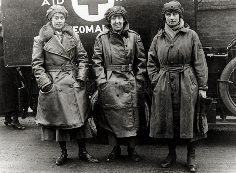 Three nurses standing outside their ambulance,  England. c 1914-1918