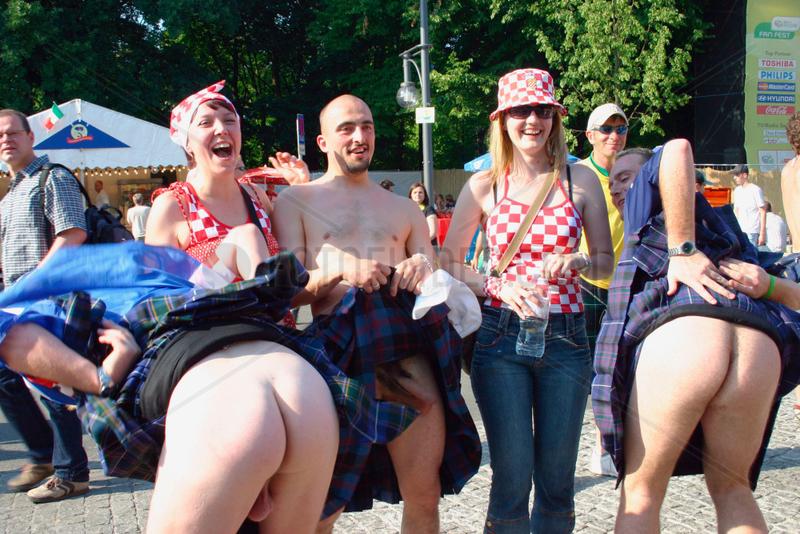 Germany. Berlin - schotland and croatian football fan at a streetparty