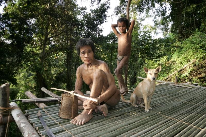Man and boy on a platform Tau't Batu Palawan Philippines