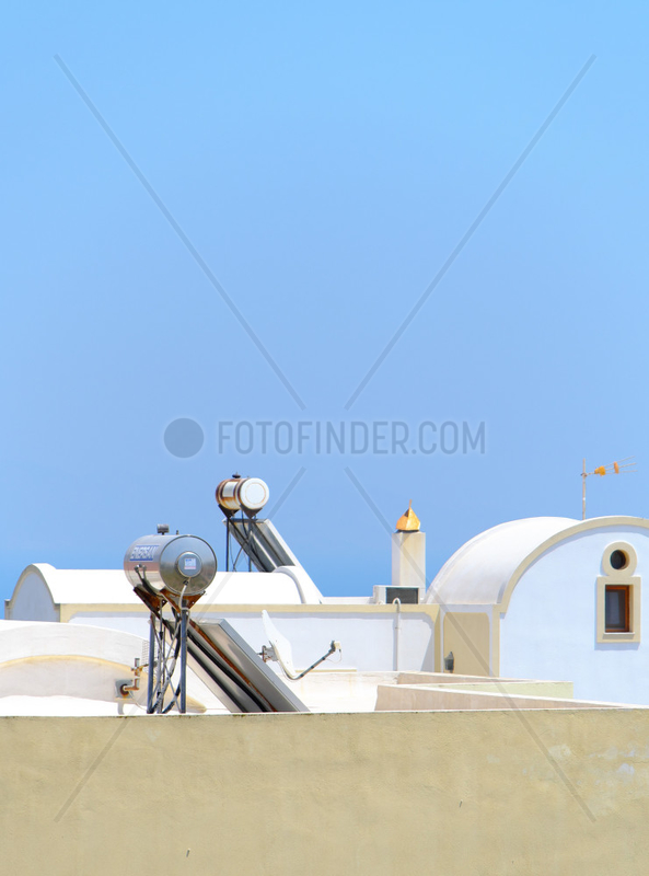 Solar hot water tank on a roof,  Santorini island,  Cyclades,  Greece.