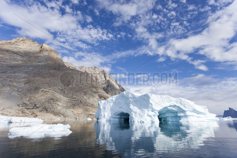 Rocky shore and iceberg - Scoresby Fjord Greenland