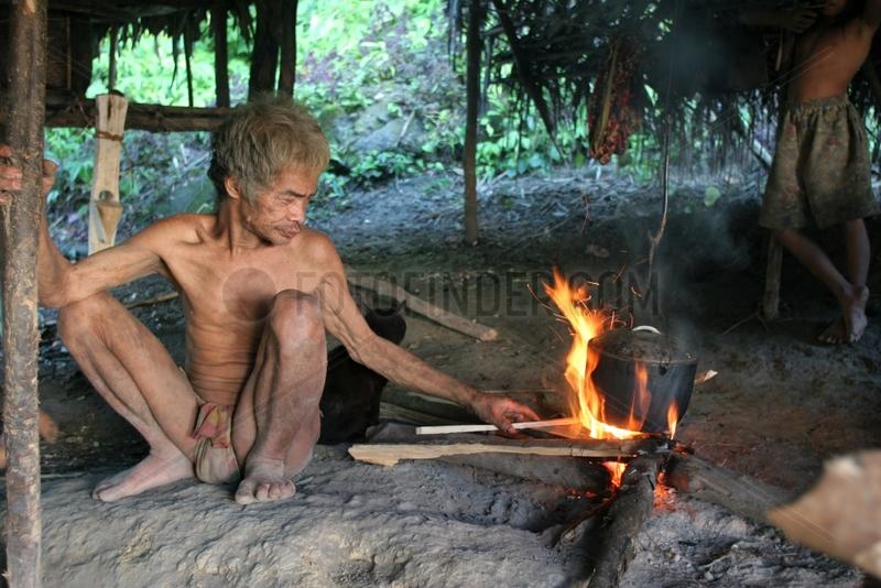 Man maintaining fire Tau't Batu Palawan Philippines
