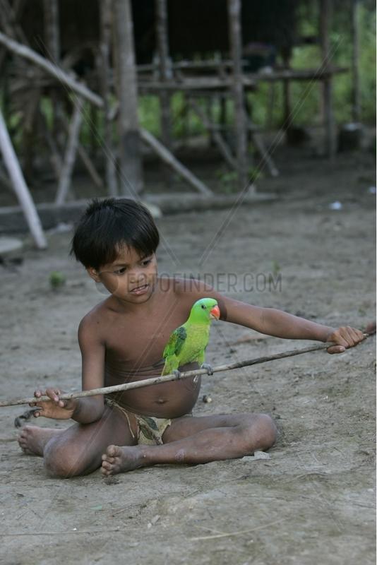 Boy and Parrot tamed Tau't Batu Palawan Philippines