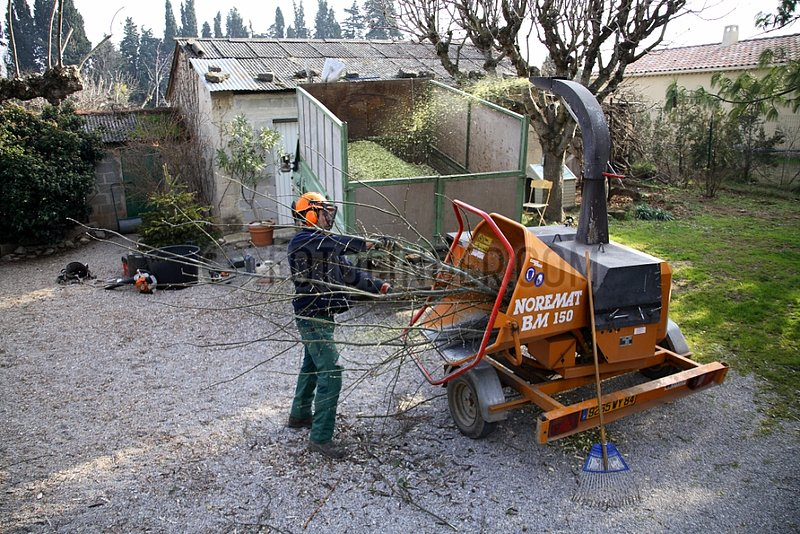 Man working with a machine for crushing plant