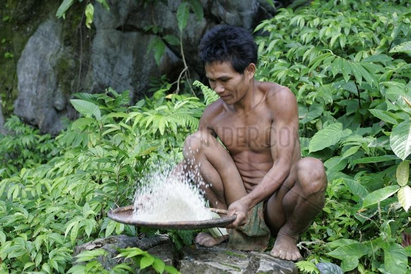 Man sifting food Tau't Batu Palawan Philippines