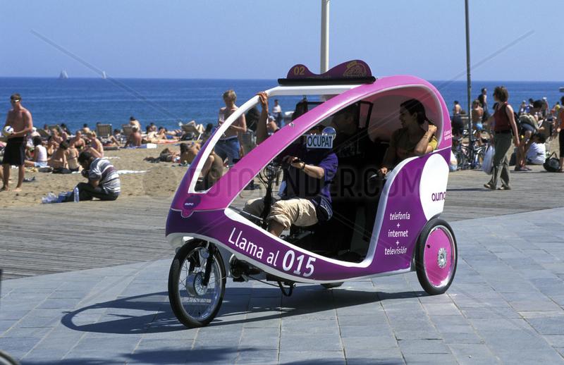 Barcelona,  a bike taxi at the beach of Barceloneta