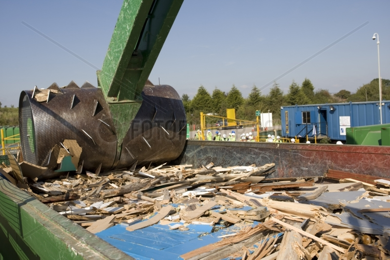 Wood crusher shreddings timber at a domestic recycling site