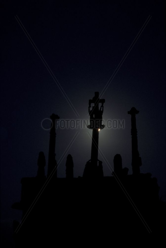 Full Moon behind the Notre-Dame de Tronoën calvary Brittany