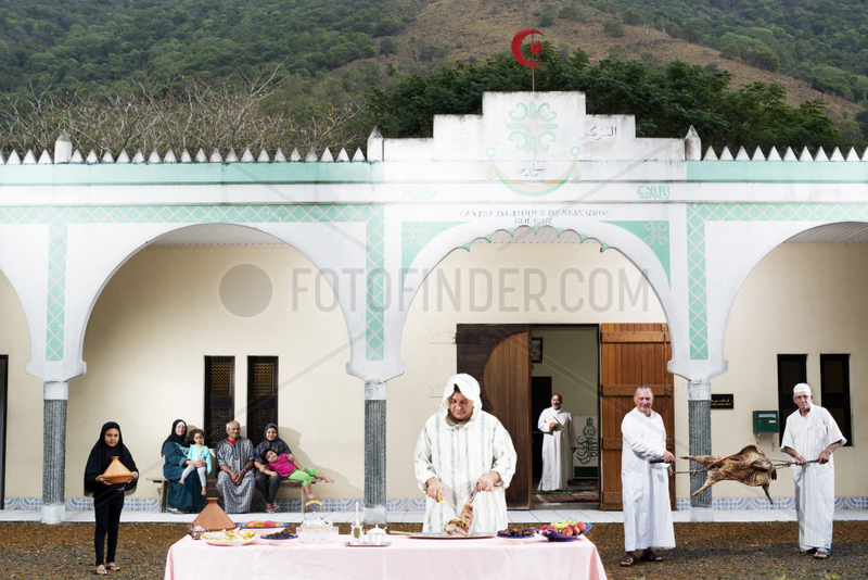 Descendants of Algerian convicts preparing a meal in front of a mosque. New Caledonia