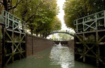 Footbridge and lock in Canal Saint-Martin in Paris France