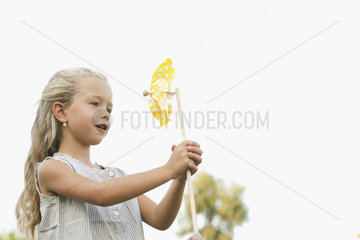 Little girl holding pinwheel