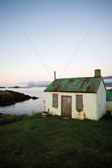 Shed at water's edge  Vopnafjordur  Austurland  Iceland