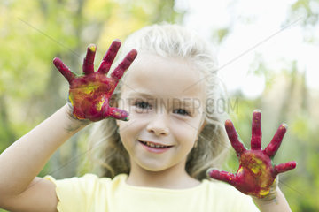 Girl with paint covered hands  portrait
