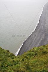 Elevated view of black sand beach  Dyrhólaey peninsula  Iceland