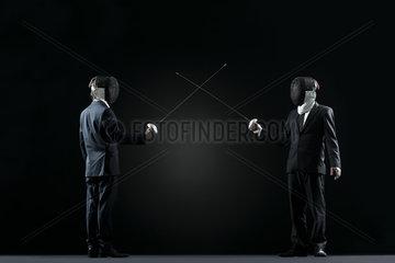 Businessmen at beginning of fencing bout