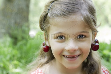 Girl with cherries dangling from her ears