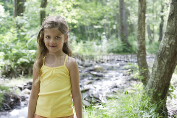 Girl by stream in woods  portrait