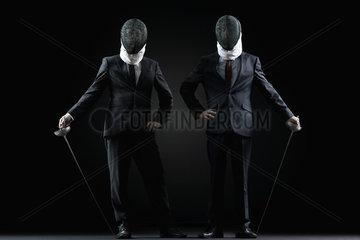 Businessmen with fencing masks and foils