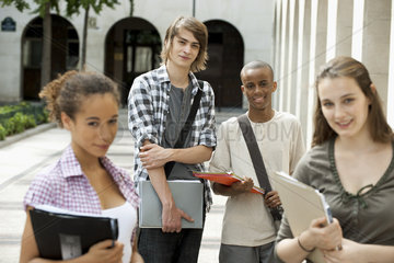 University students on campus  focus on man in background
