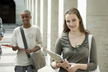 University students on campus  focus on woman in foreground