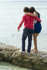 Couple walking on jetty  rear view