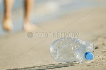 Abandoned plastic water bottle on beach