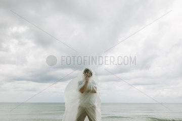 Man contemplating in plastic