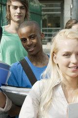 Male university student among friends