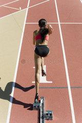 Female runner at starting line  rear view