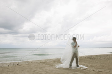 Man wrapped in plastic on beach