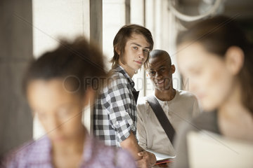 Young man with friend  focus on one person