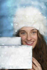 Young woman holding Christmas presents  portrait