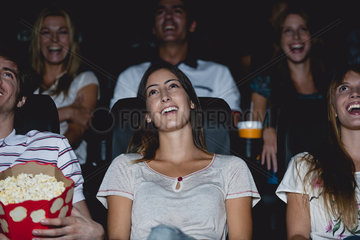 Audience laughing in movie theater