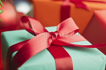 Festively wrapped Christmas gift  close-up