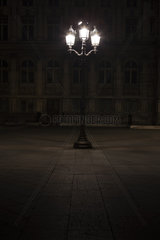 Street lamp illuminated at night in Place de l'Hotel de Ville  Paris  France