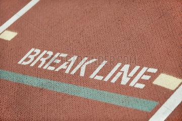 Break line marking on running track lane