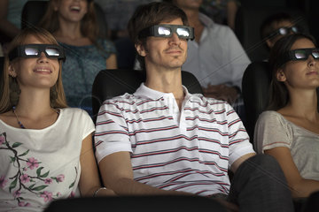 Audience enjoying 3-D movie in theater