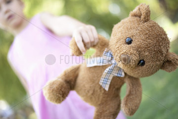Girl holding teddy bear  low angle view