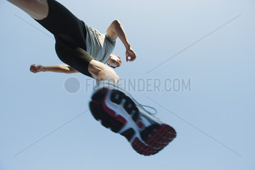 Runner in mid-stride  viewed from directly below