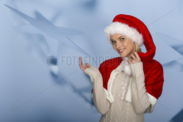 Woman wearing Santa hat in front of festive background  portrait