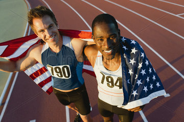 Running teammates holding up American flag after race